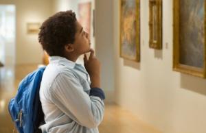 boy looking at painting